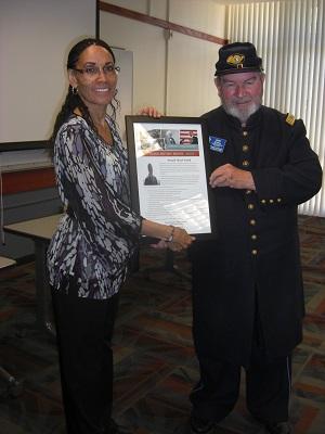 Tressa Aldredge of CRC presents an appreciation award to Brad Schall.