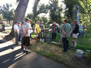 Cemetery Preservationist Sharon Patrician (3rd from right) instructs the clean-up crew