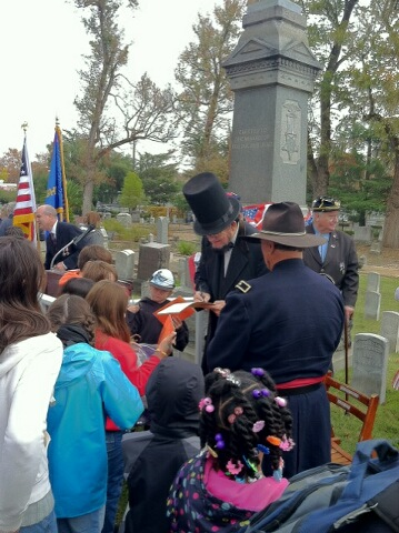 President Lincoln (porttrayed by Wayne Scott) signs autographs and answers questions after the ceremony.